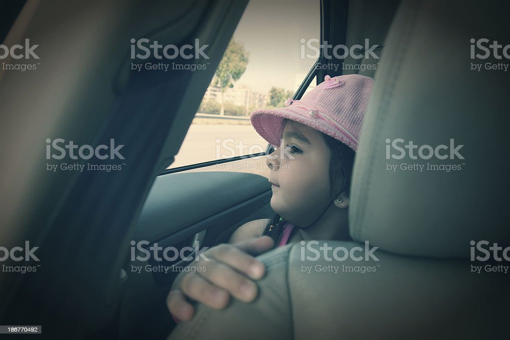 little girl in car royalty-free stock photo