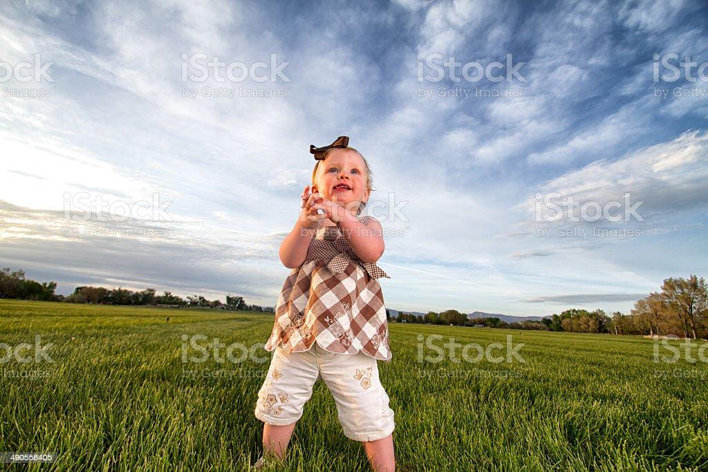 Little Girl in Field stock photo