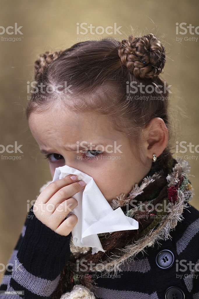 Little girl in flu season - blowing nose royalty-free stock photo