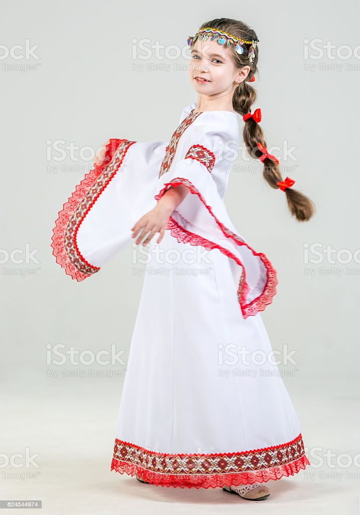 Little Girl In Folk Clothes stock photo