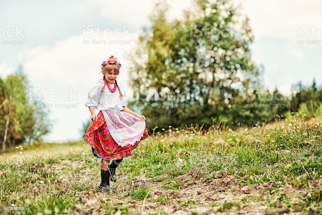 Little girl in folk costume (Krakowianka) stock photo