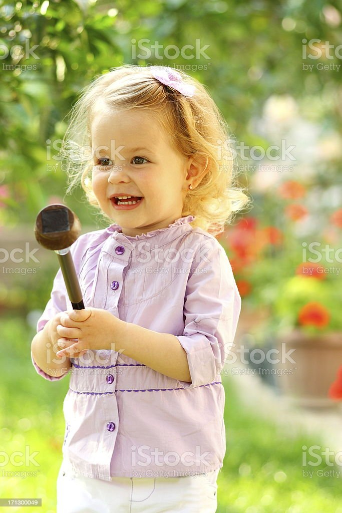 Little girl in garden royalty-free stock photo