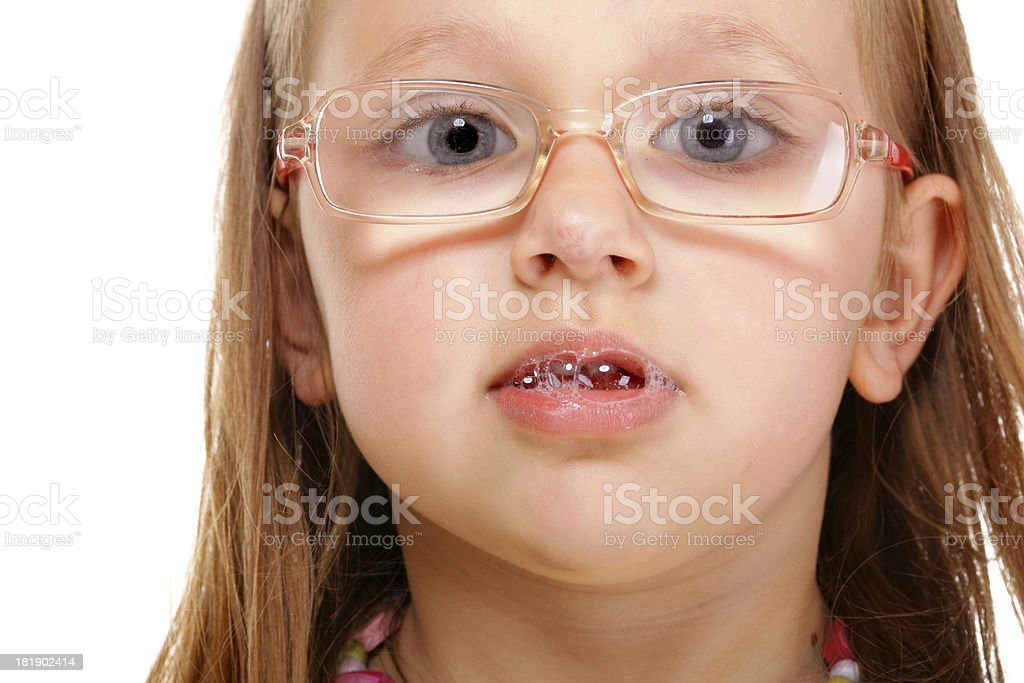 little girl in glasses doing fun isolated stock photo