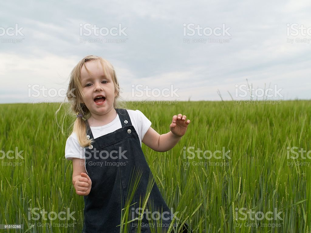 little girl in green field royalty-free stock photo