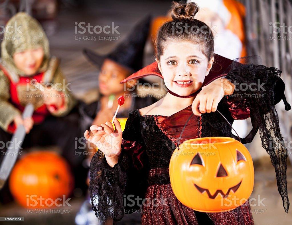 Little girl in halloween costume stock photo