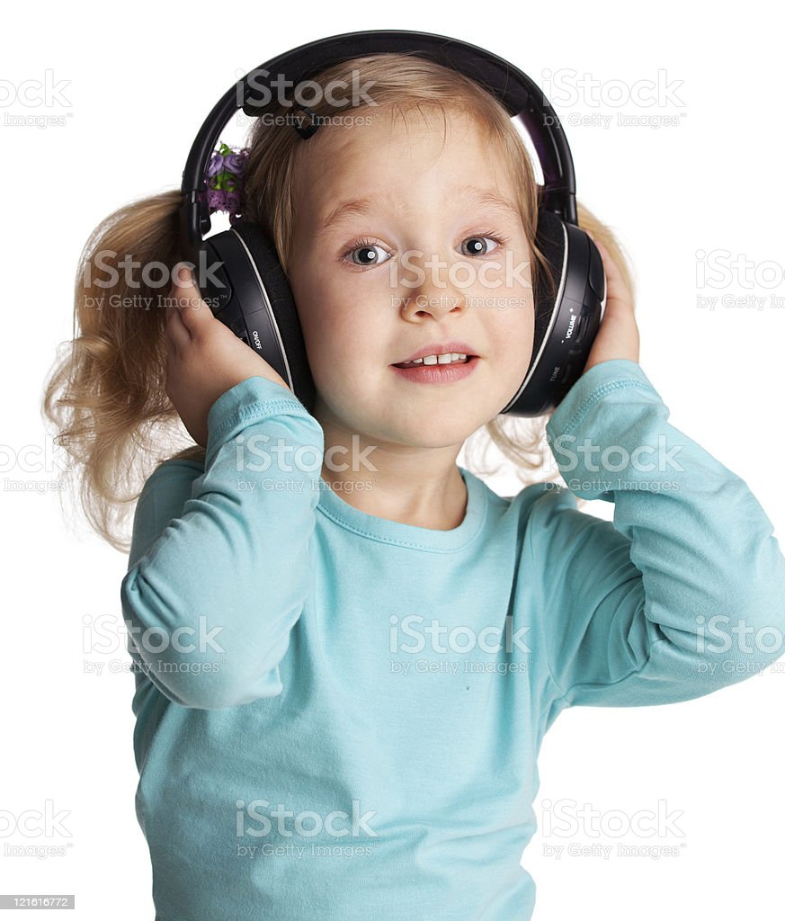 Little girl in headphones stock photo
