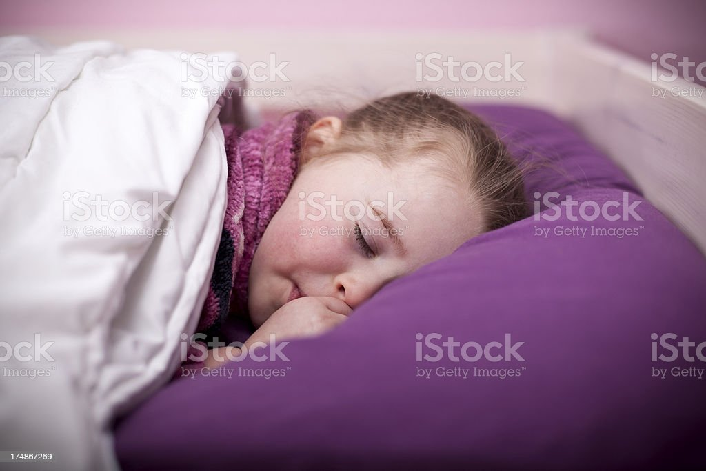 Little girl in her bed royalty-free stock photo