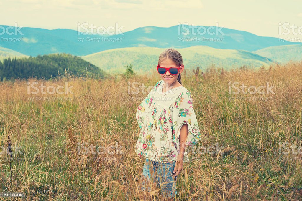 Little girl in hippie style stock photo