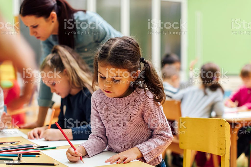 Little Girl in kindergarten stock photo