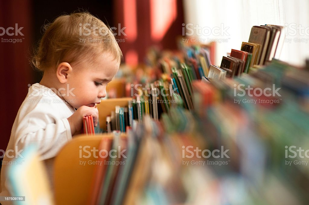 Little girl in library stock photo
