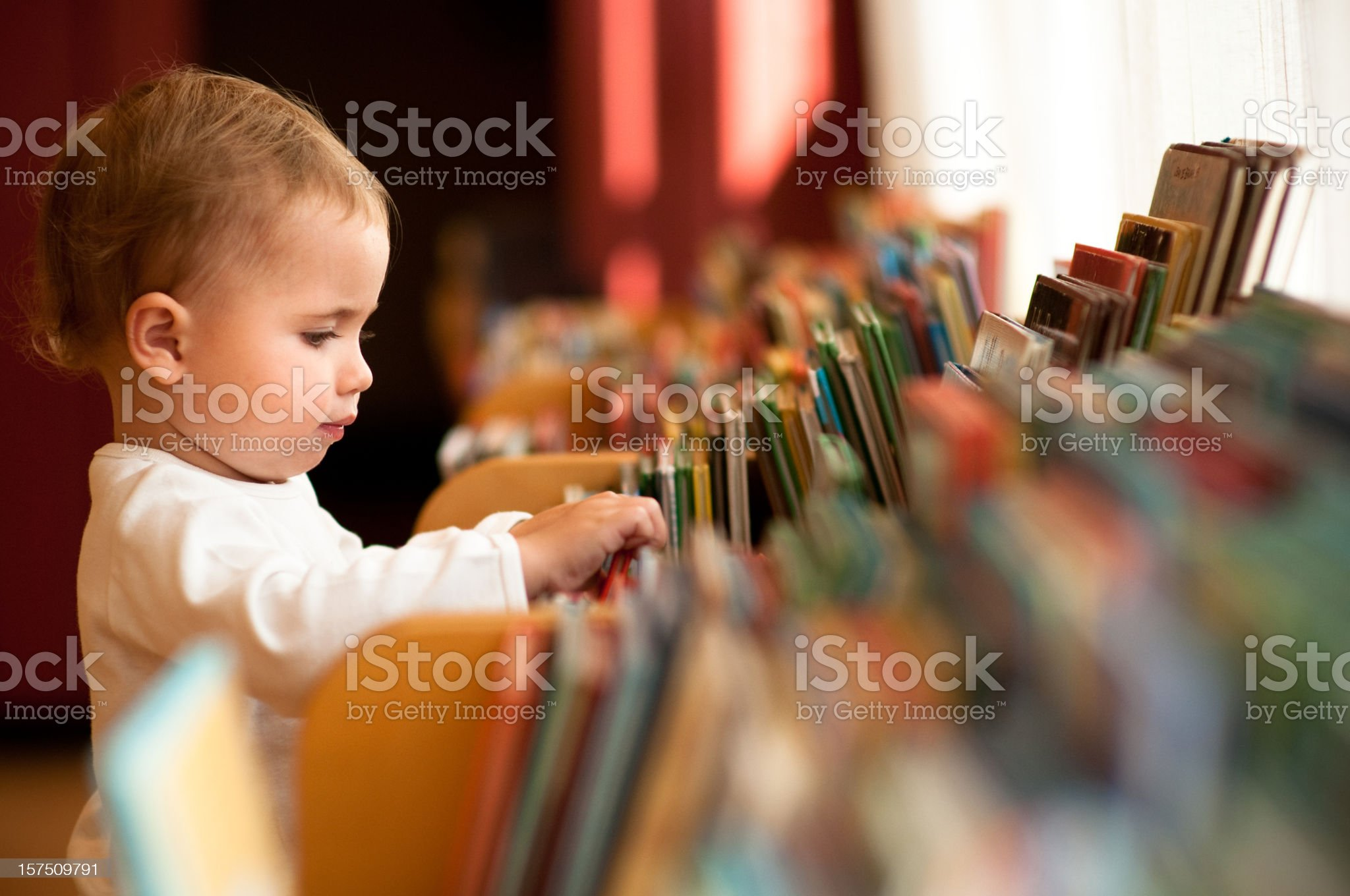Little girl in library royalty-free stock photo