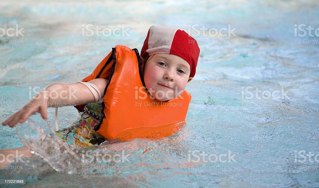 Little girl in life-jacket at the swimming pool royalty-free stock photo