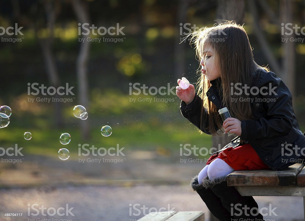 Little girl in nature that bubbles royalty-free stock photo