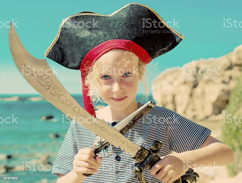 Little girl in pirate costume with sword. stock photo