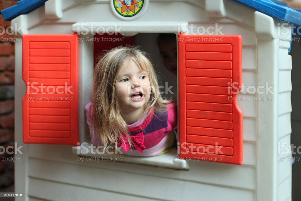Little girl in playground stock photo