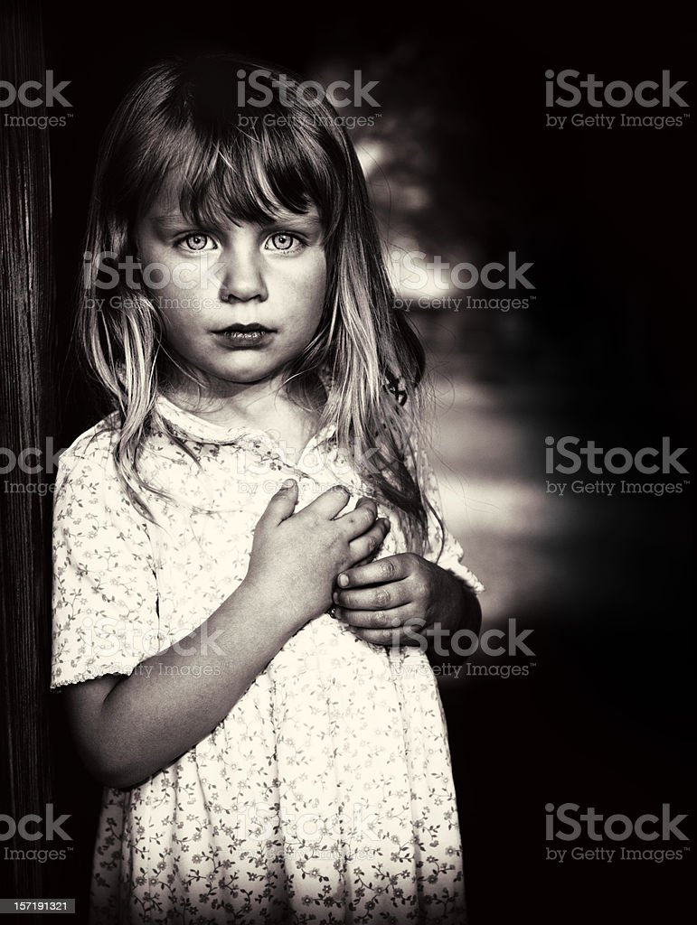 Little girl in poverty stock photo