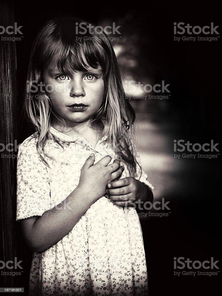Little girl in poverty stock photo