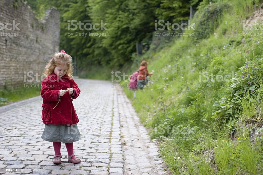 Little girl in red, shut out from fun royalty-free stock photo
