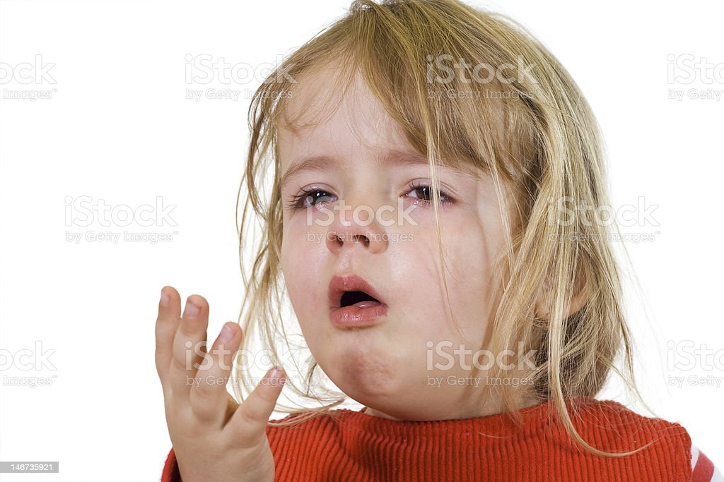 A little girl in red with flu looking sick stock photo