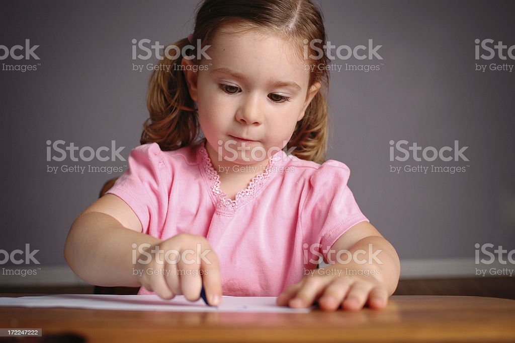 Little Girl in School Desk Learning to Write royalty-free stock photo