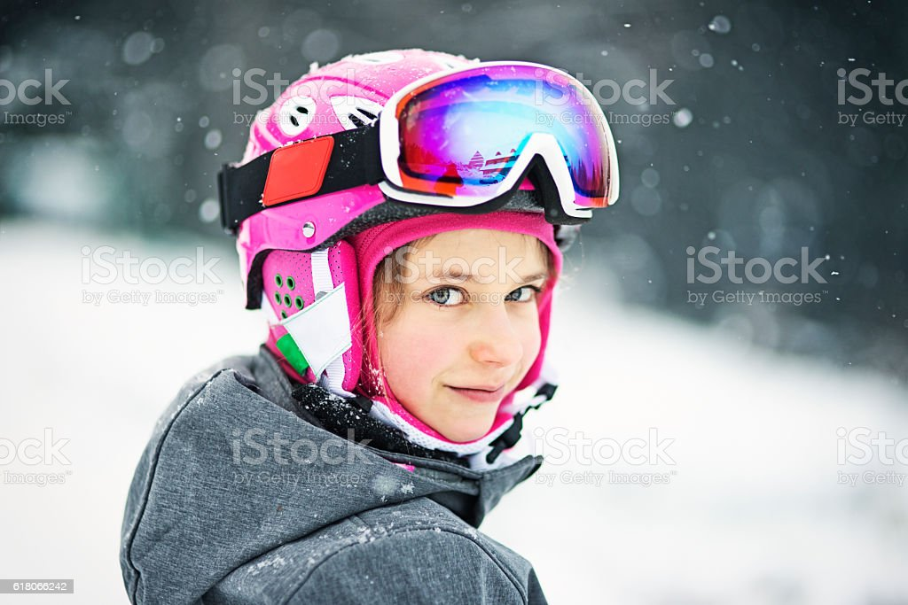 Little girl in ski gear stock photo
