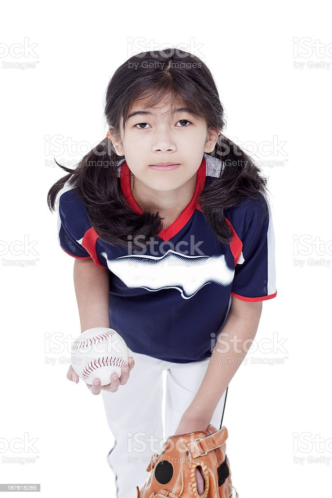 Little biracial asian girl in softball team uniform ready to throw a...