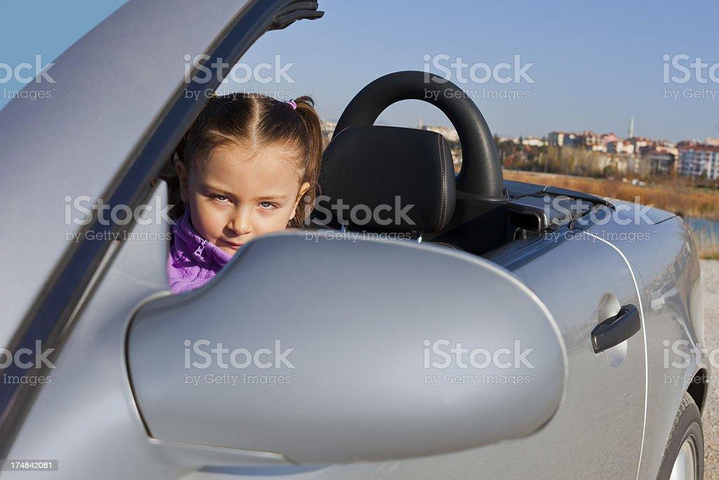 Little girl in sport car royalty-free stock photo