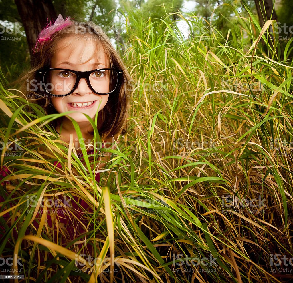 Little girl in tall grass royalty-free stock photo