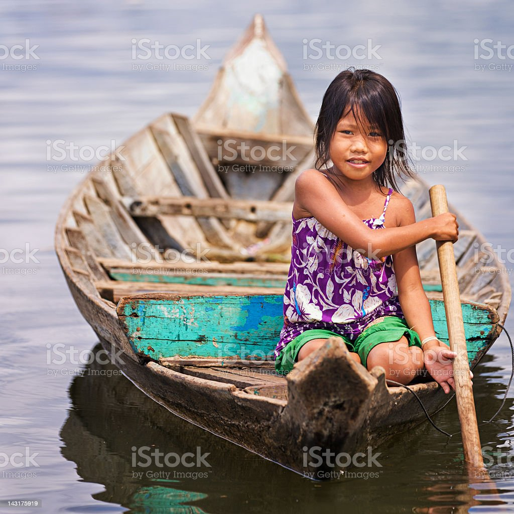 Little girl in the boat, Cambodia royalty-free stock photo