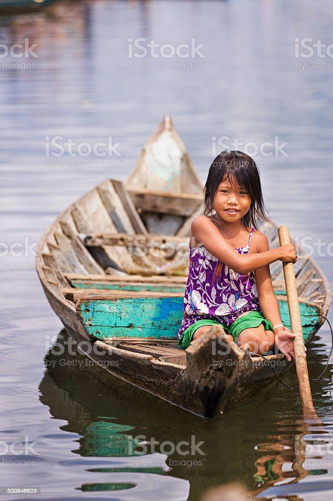 Little girl in the boat, Cambodia stock photo