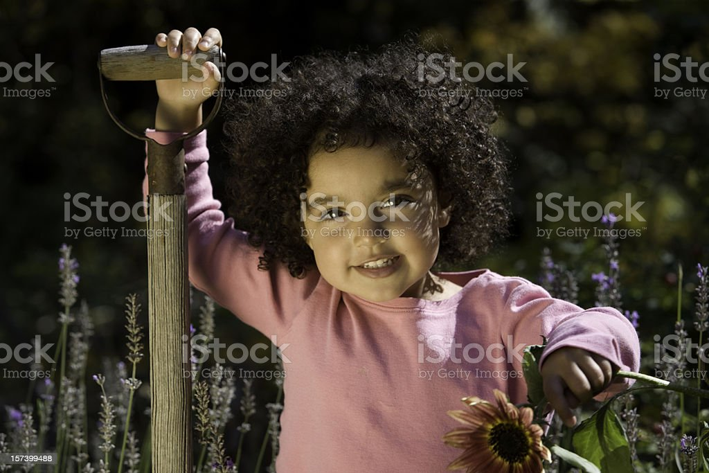 Little Girl in the Garden royalty-free stock photo