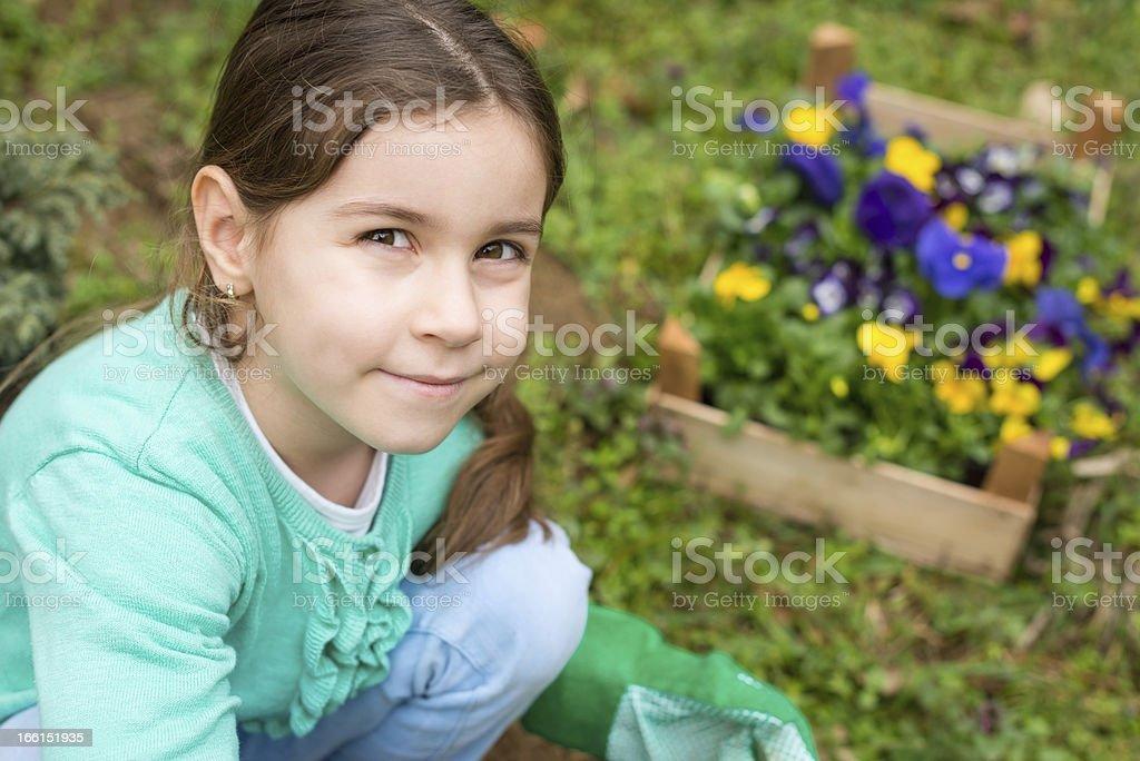 Little girl in the garden royalty-free stock photo