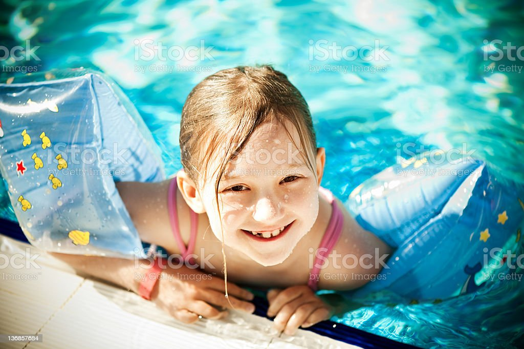 Little girl in the pool stock photo