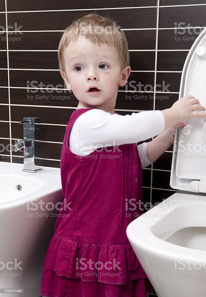 Little girl (16 months) in the toilet. royalty-free stock photo