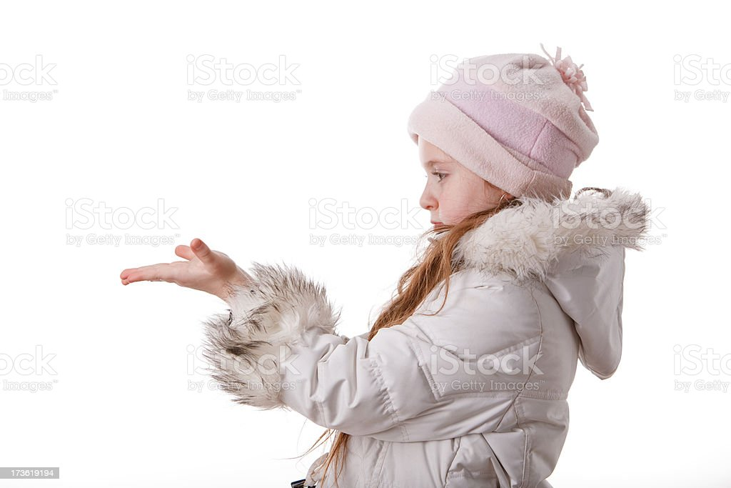 Little girl in the white coat show something on palms royalty-free stock photo