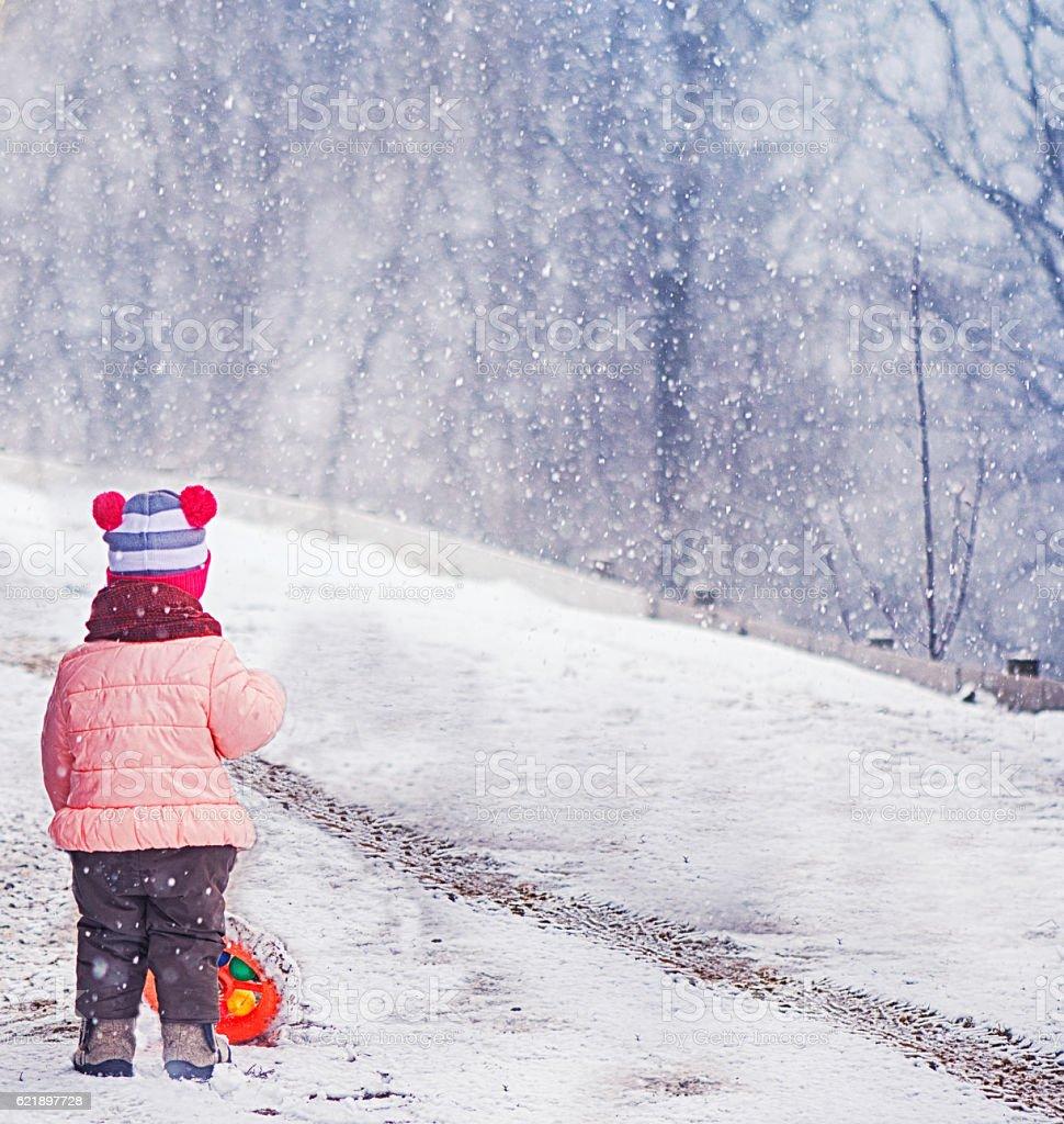 Little Girl in the Winter stock photo