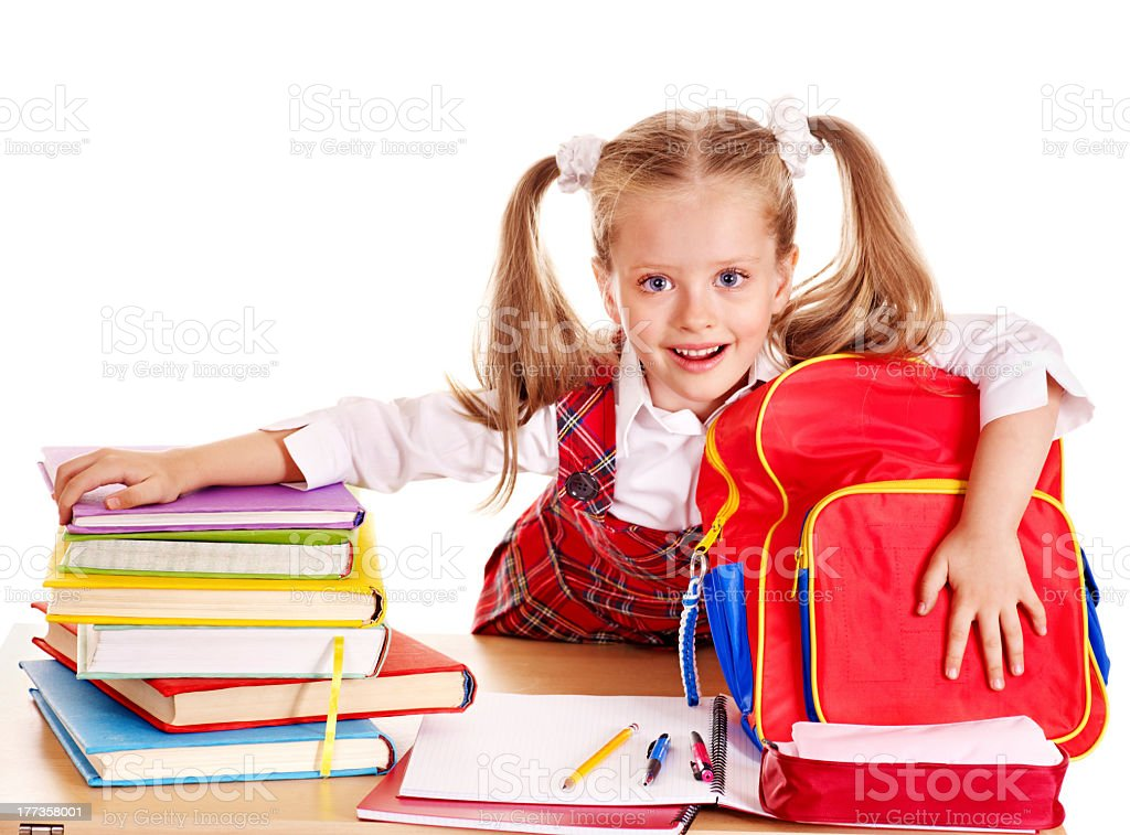 Little girl in uniform with book stack and schoolwork royalty-free stock photo