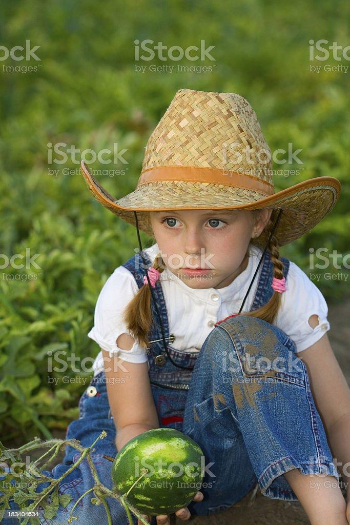 Little girl in watermelon field royalty-free stock photo