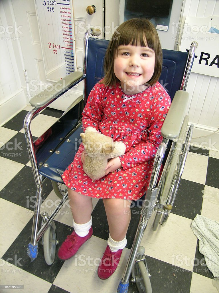 Little girl in wheelchair royalty-free stock photo