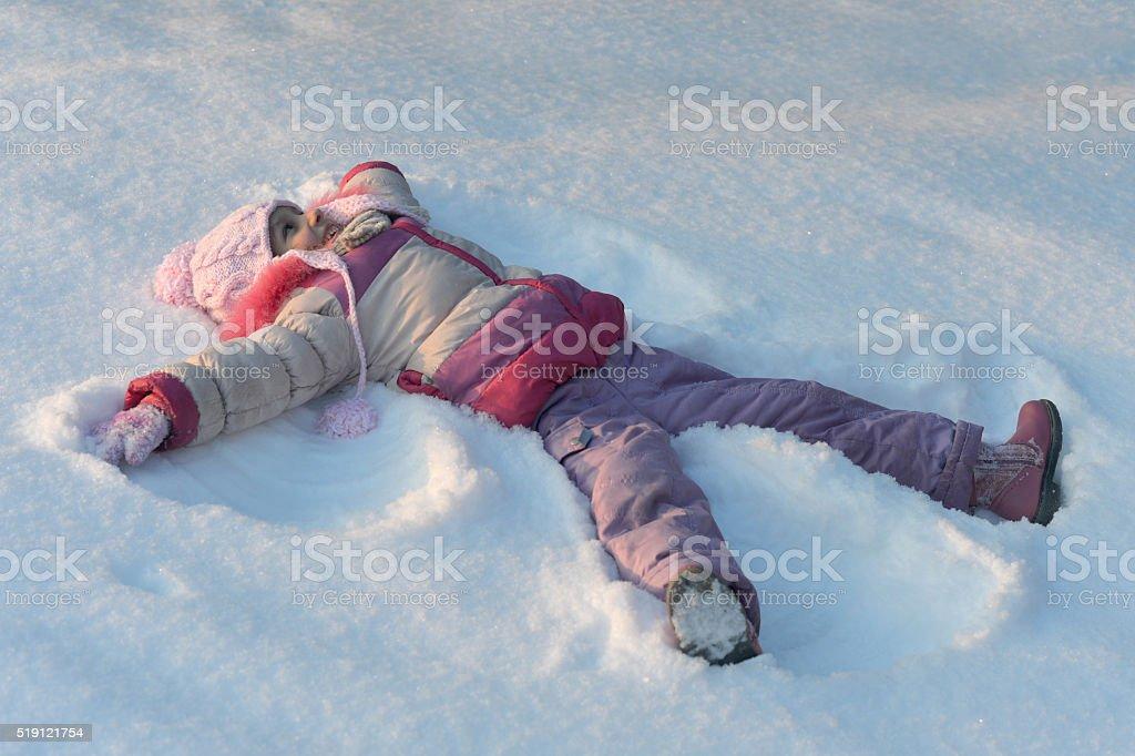 little girl in winter park stock photo