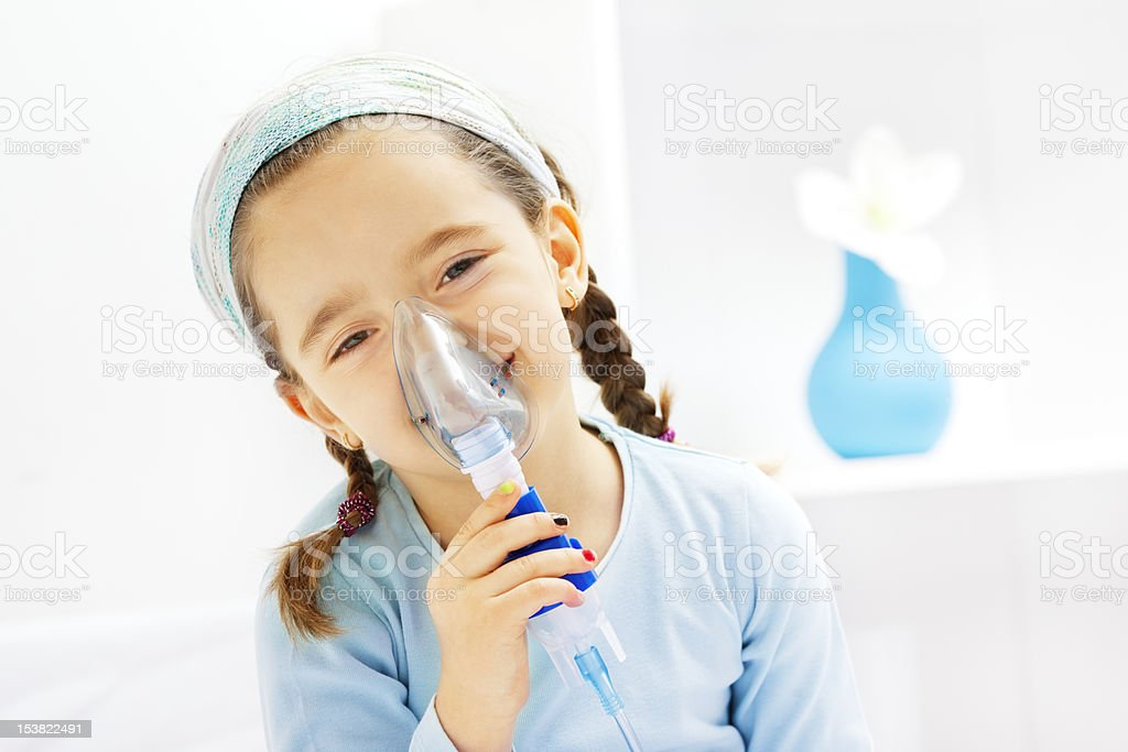 Little Girl Inhaling Cough Medicine stock photo