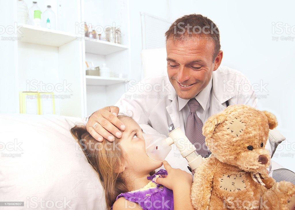 Little girl inhaling medicine royalty-free stock photo