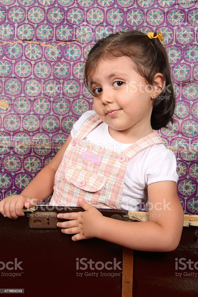 Little Girl Inside Old Trunk royalty-free stock photo