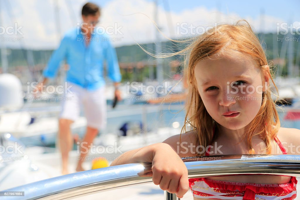 Little girl is being bored on summer vacation stock photo
