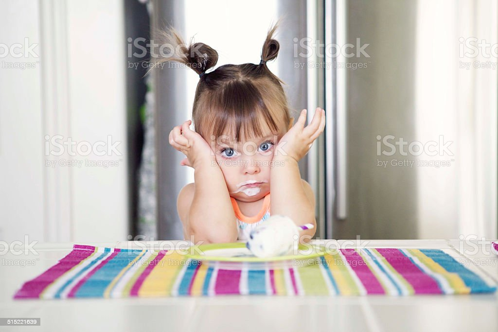 Little Girl is Eating Ice Cream stock photo