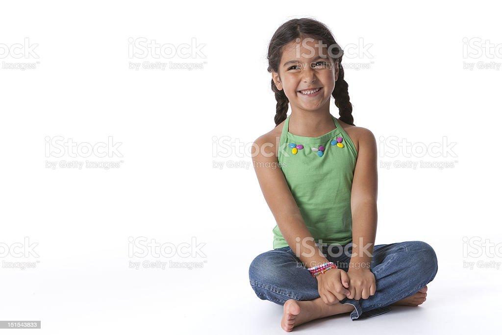 Little girl is having fun sitting on the floor royalty-free stock photo
