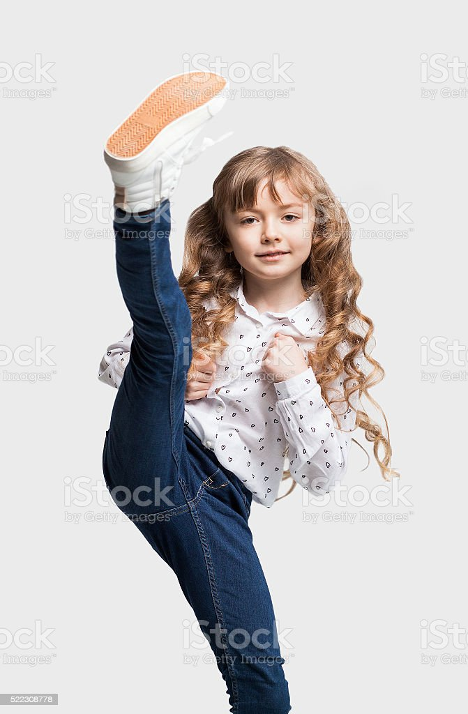 Little girl is kicking stock photo