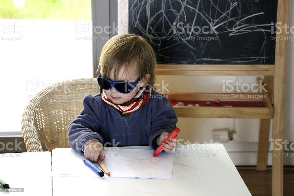 Little girl  is learning to paint royalty-free stock photo