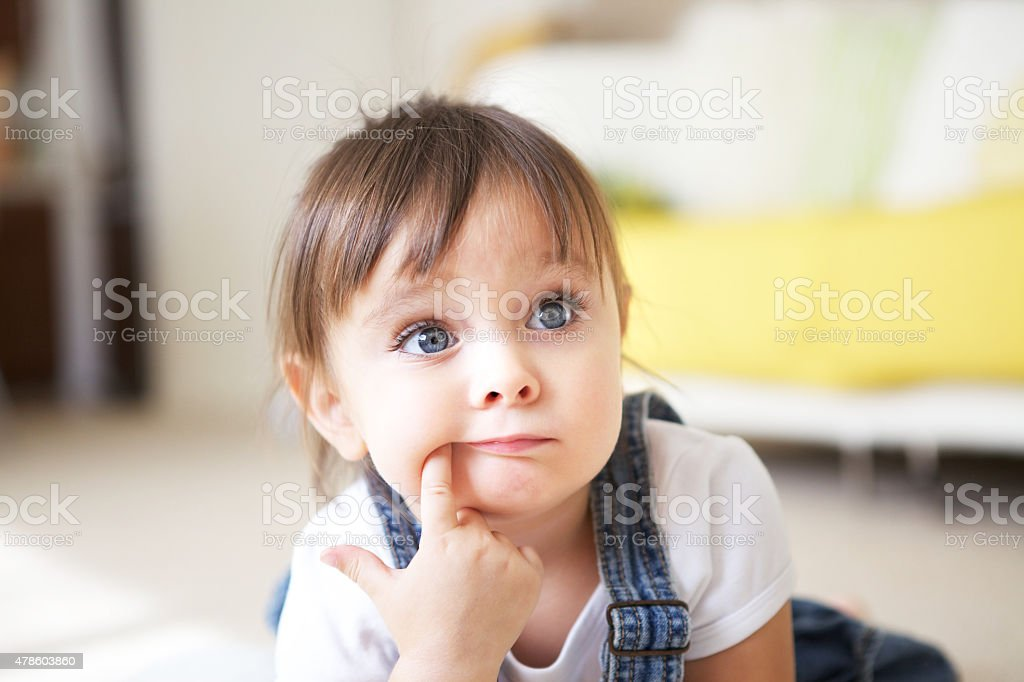 Little Girl is Listening and Thinking stock photo