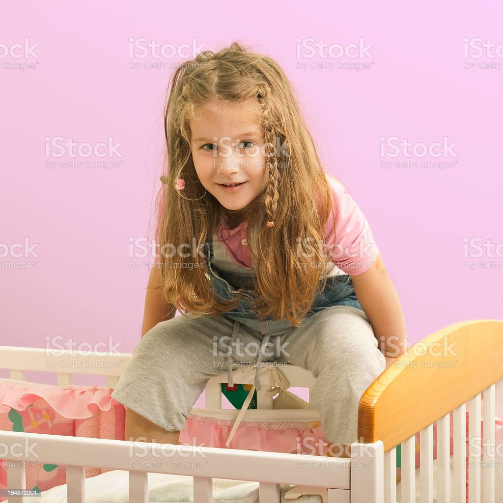 Little Girl is playing in her crib royalty-free stock photo